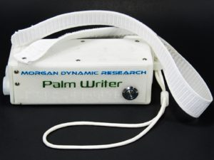 Palm Writer Top View Showing Top and Right Plates, Power Button, Wrist Strap, and Ergonomic Suspension Kit