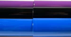 Closeup of a True Blue, Piano Black, and Plum Purple Canes to show the high gloss paint quality of each